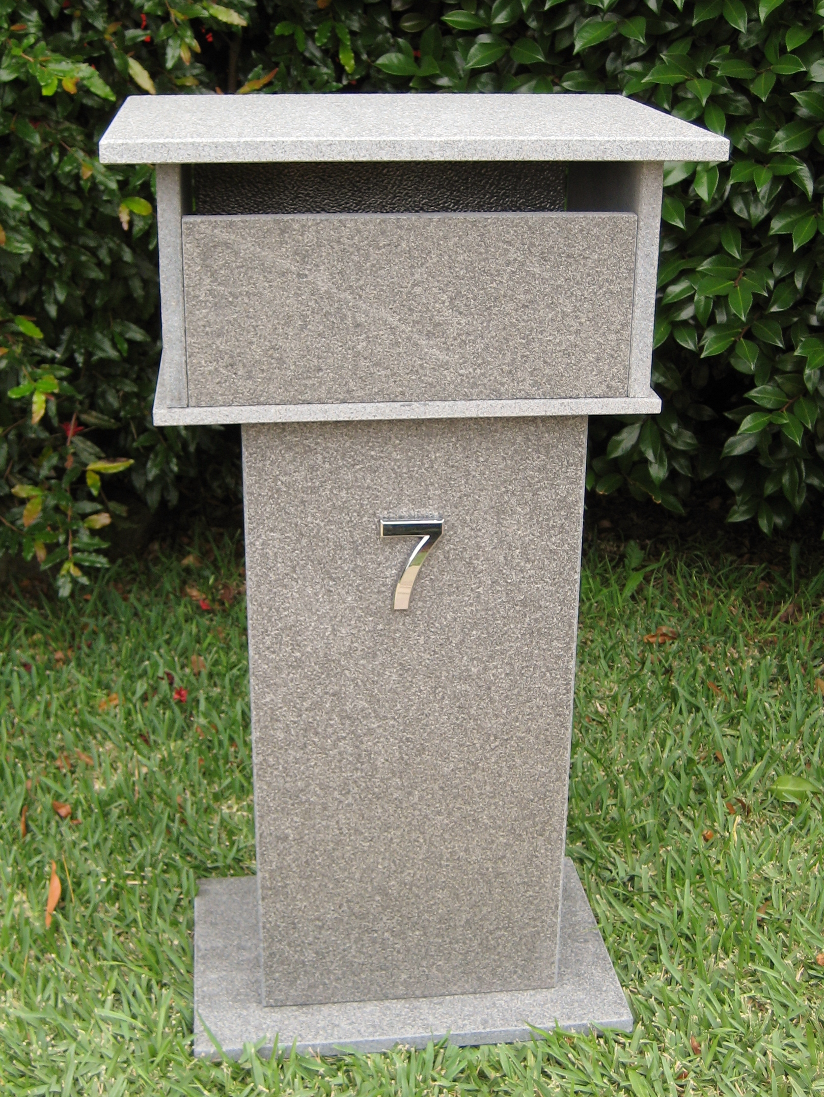 70. Blue stone letterbox with bushhammered finish. Back 2 key aluminium door. Tough material. Sizes 820x400x300 $550