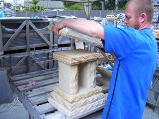 102. Stonemason constructing sandstone letterbox