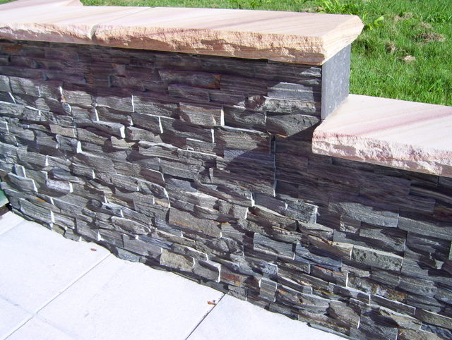 40. Gray side stacked stone made from hard slate.