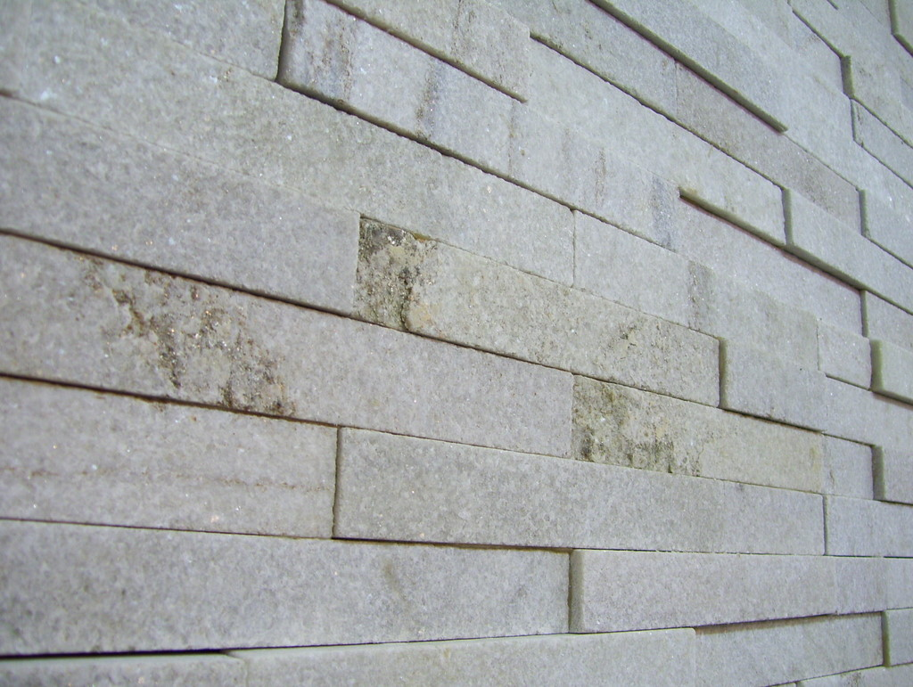 52. White crystallised quartzite stacked stone is extremely dense. Detail. Tiles 150x600mm.
