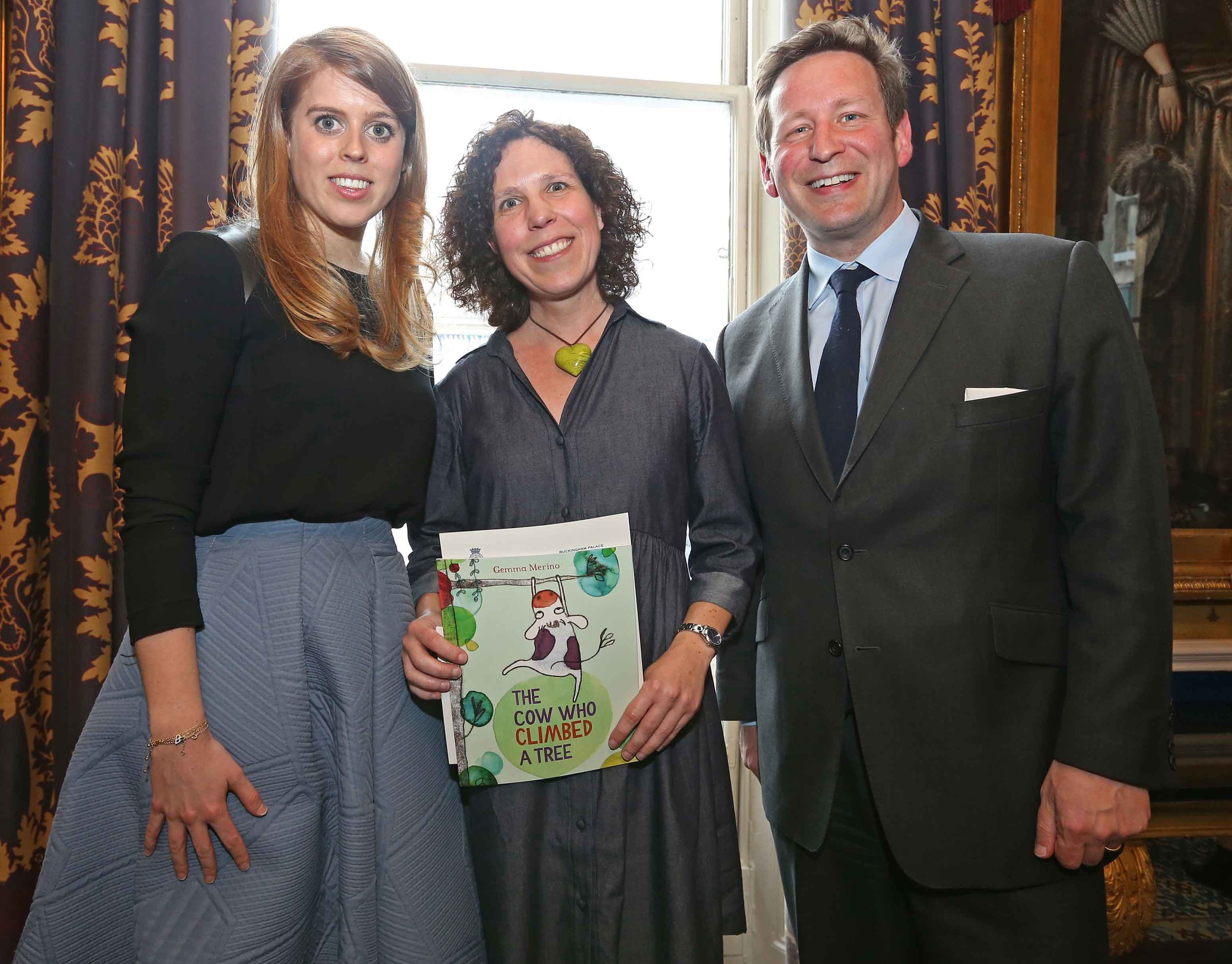 2016 winner of Oscar's Book Prize Gemma Merino, holding her winning children's book The Cow Who Climbed A Tree, seen together with HRH Princess Beatrice and Culture Minister Ed Vaizey