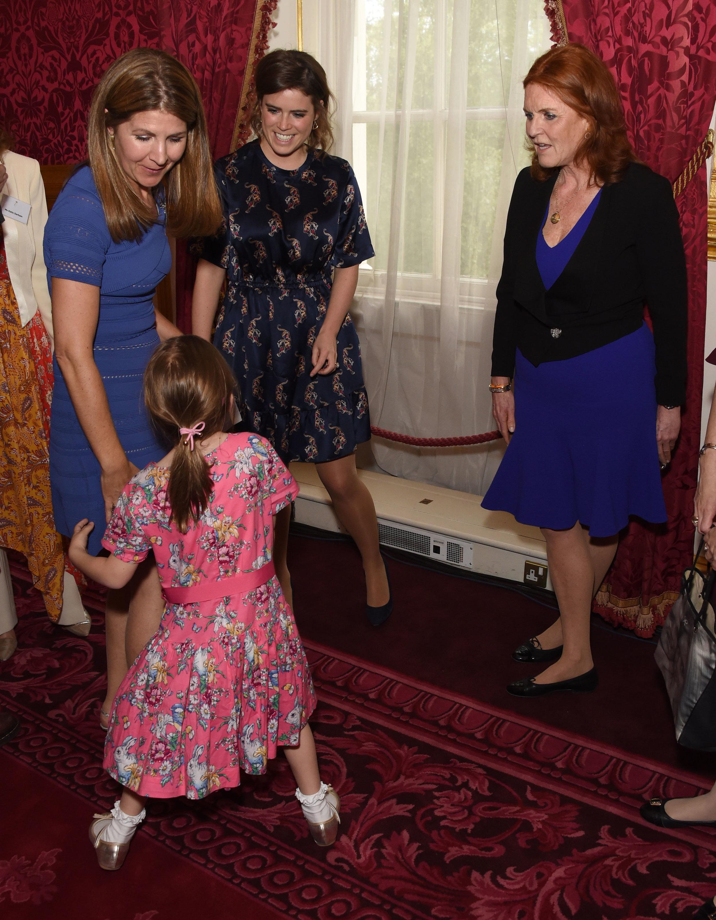 Alice Ashton, Oscar's little sister, Viveka Alvestrand, co-founder of Oscar's Book Prize, with HRH Princess Eugenie and Sarah, Duchess of York. Image: Dave Benett
