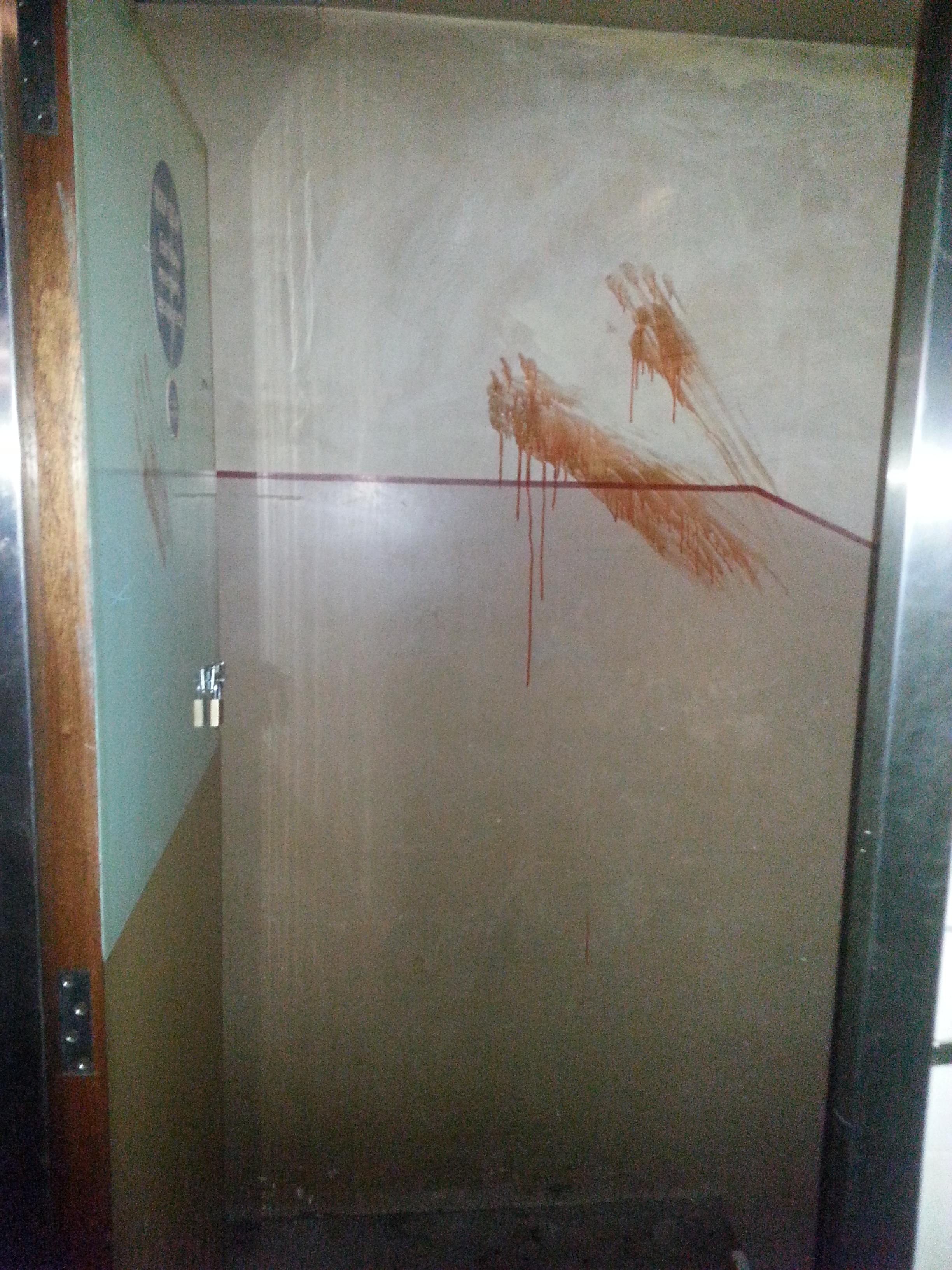 Fake blood hand prints leading down to the basement.