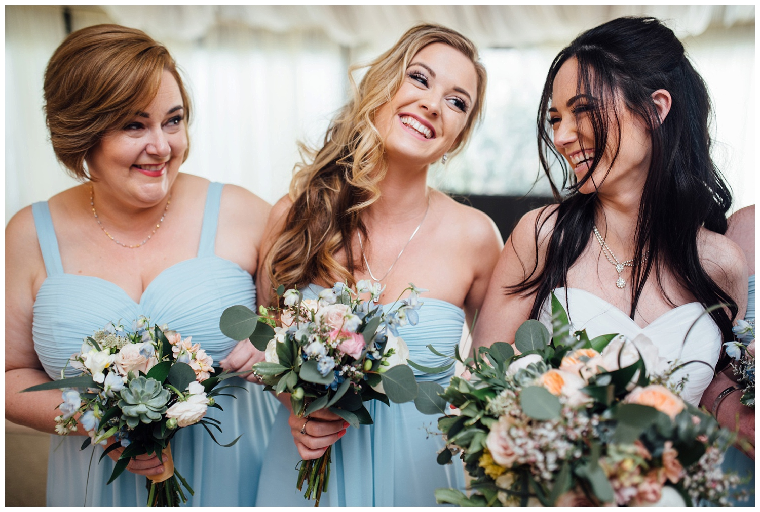New York, New Jersey and Pennsylvania wedding vendors, resources and inspiration for the modern couple | Bridesmaids light blue dresses