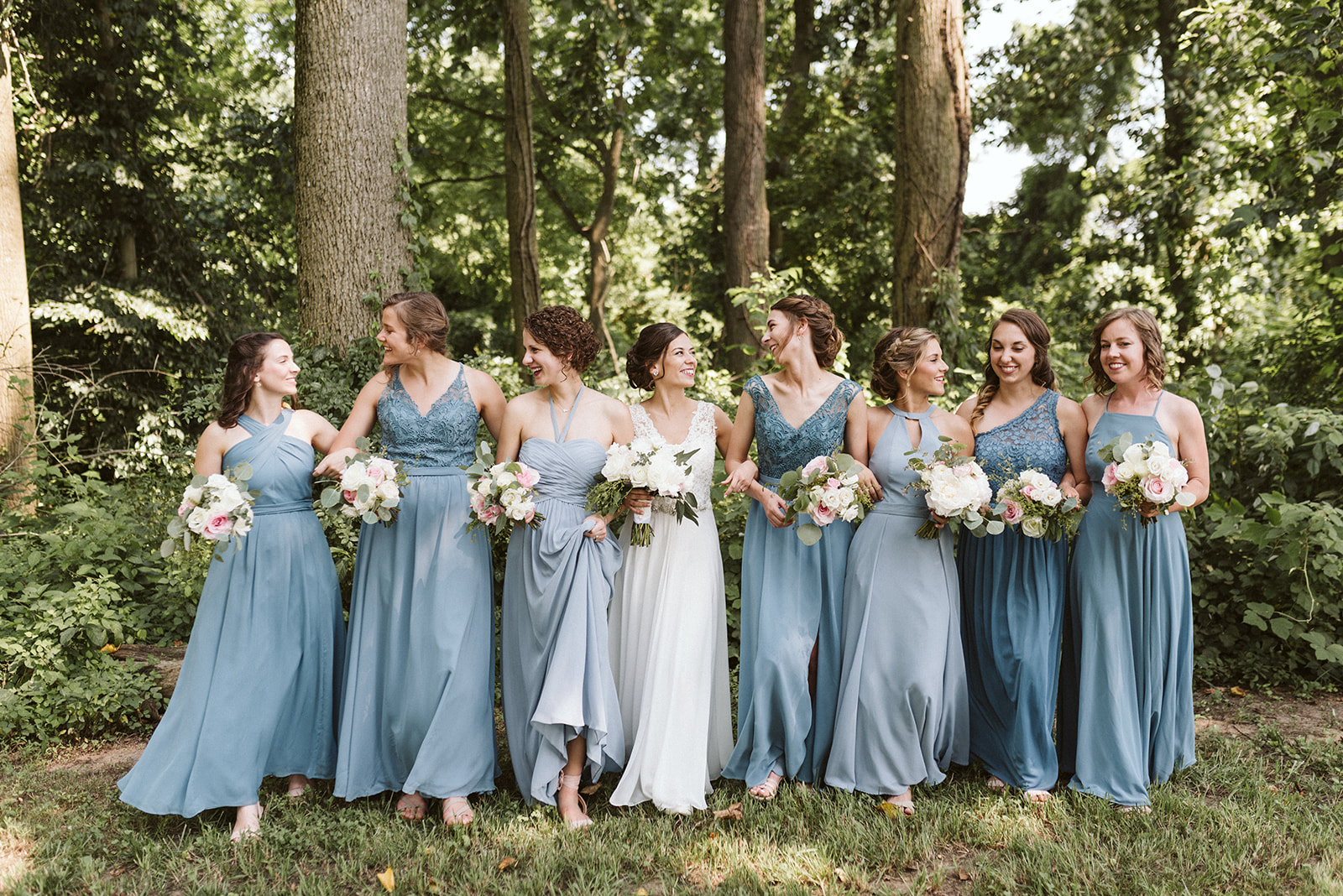 Outdoor wedding in Lancaster, Pennsylvania. Slate blue bridesmaid dresses, fluffy bouquets.