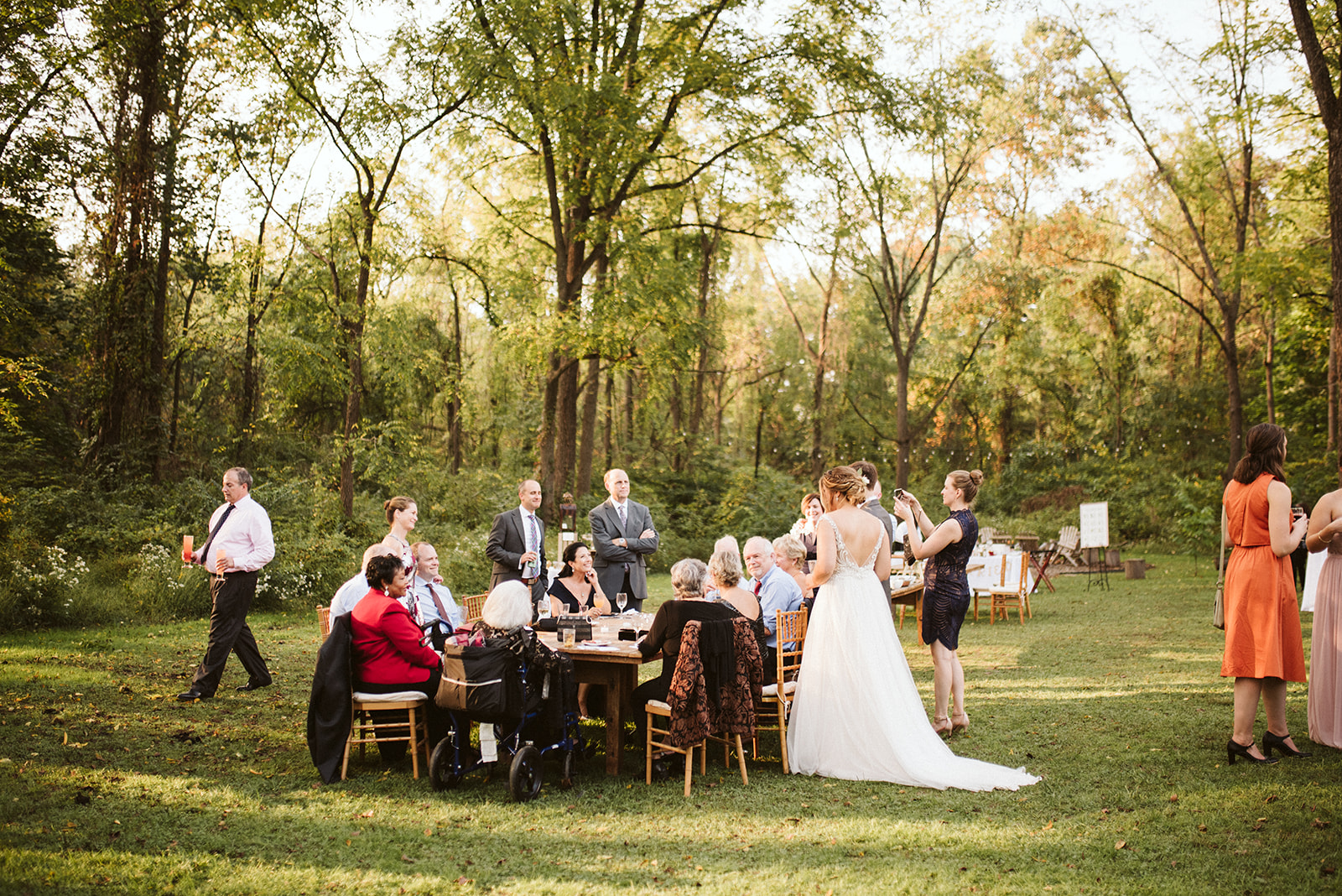 Couple and guests enjoying cocktail hour at Historic Anthony Wayne House for a wedding near Philadlephia, Pennsylvania.