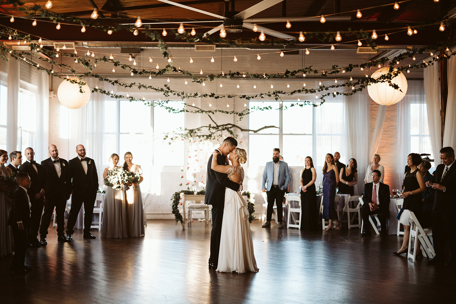 First dance in an art gallery at the Reading Art Works event venue near Philadelphia. The bride is wearing a gown by designer, Miss Haley Paige.