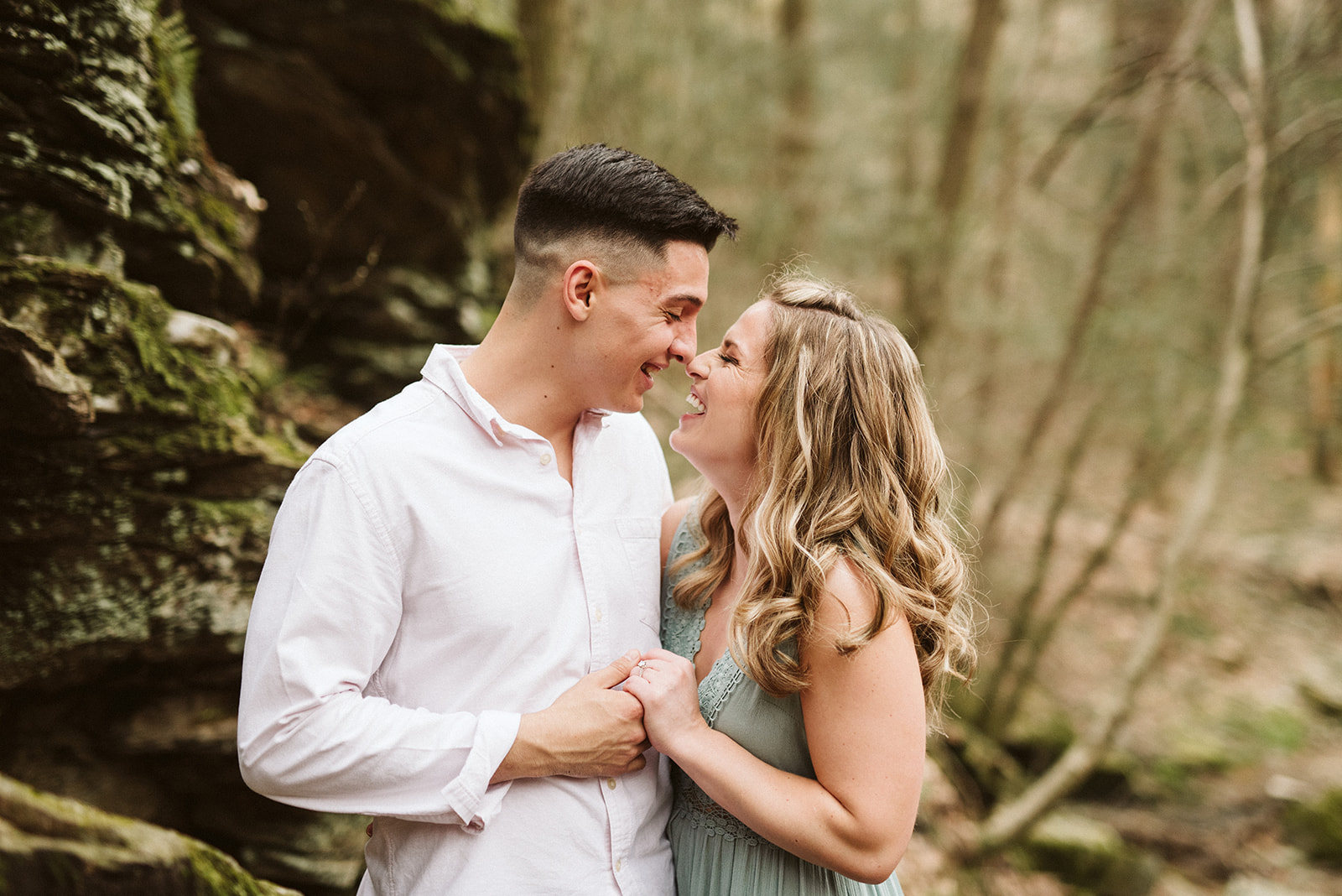 Laughing couple during their outdoorsy, adventurous engagement session near Philadelphia, Pennsylvania.
