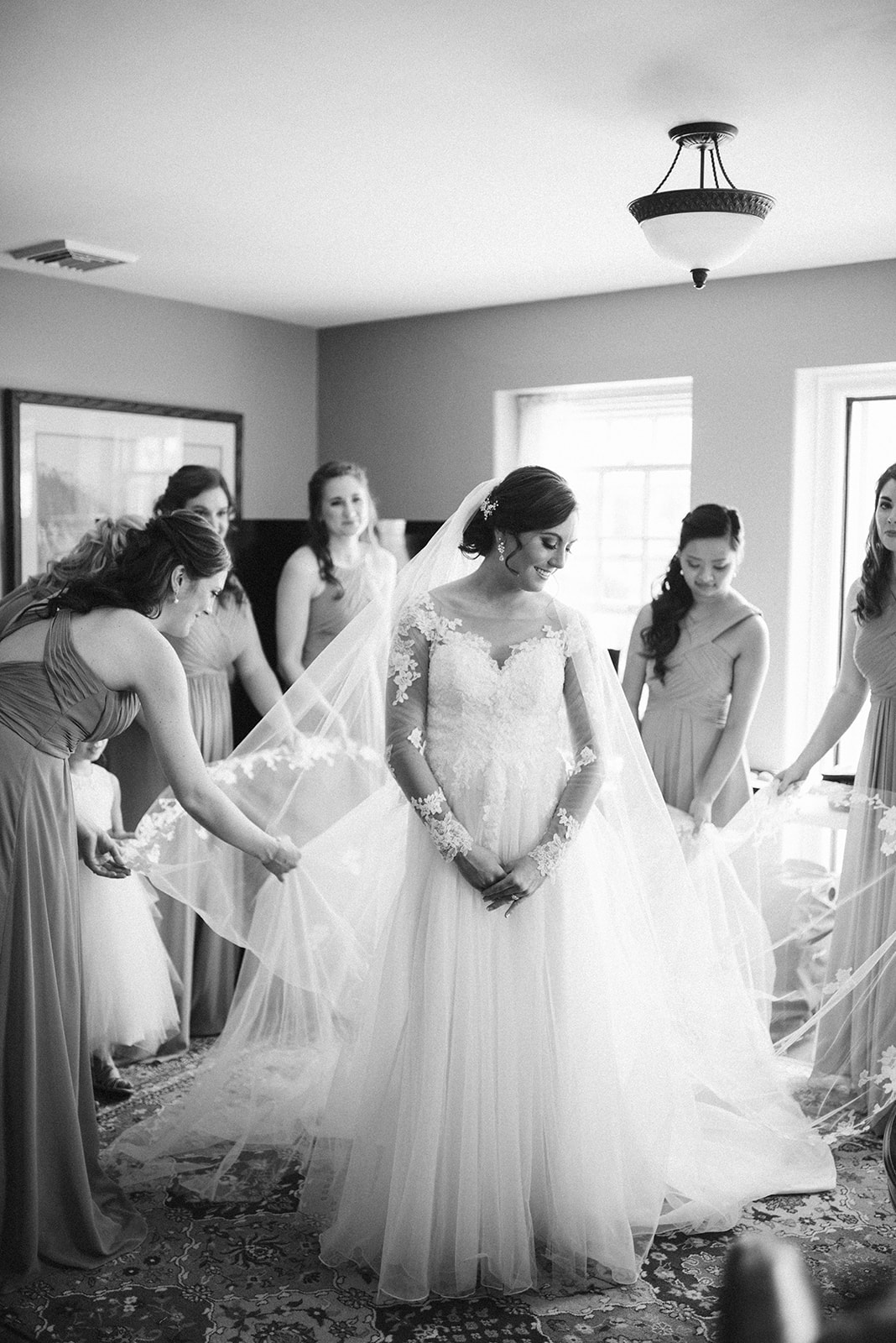 Bride and bridesmaids getting ready at Drumore Estate within their wedding bridal suite.