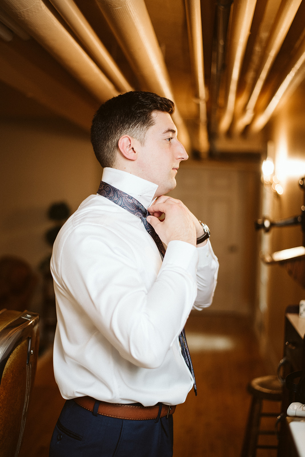 The groom is getting ready at Drumore Estate for his wedding.