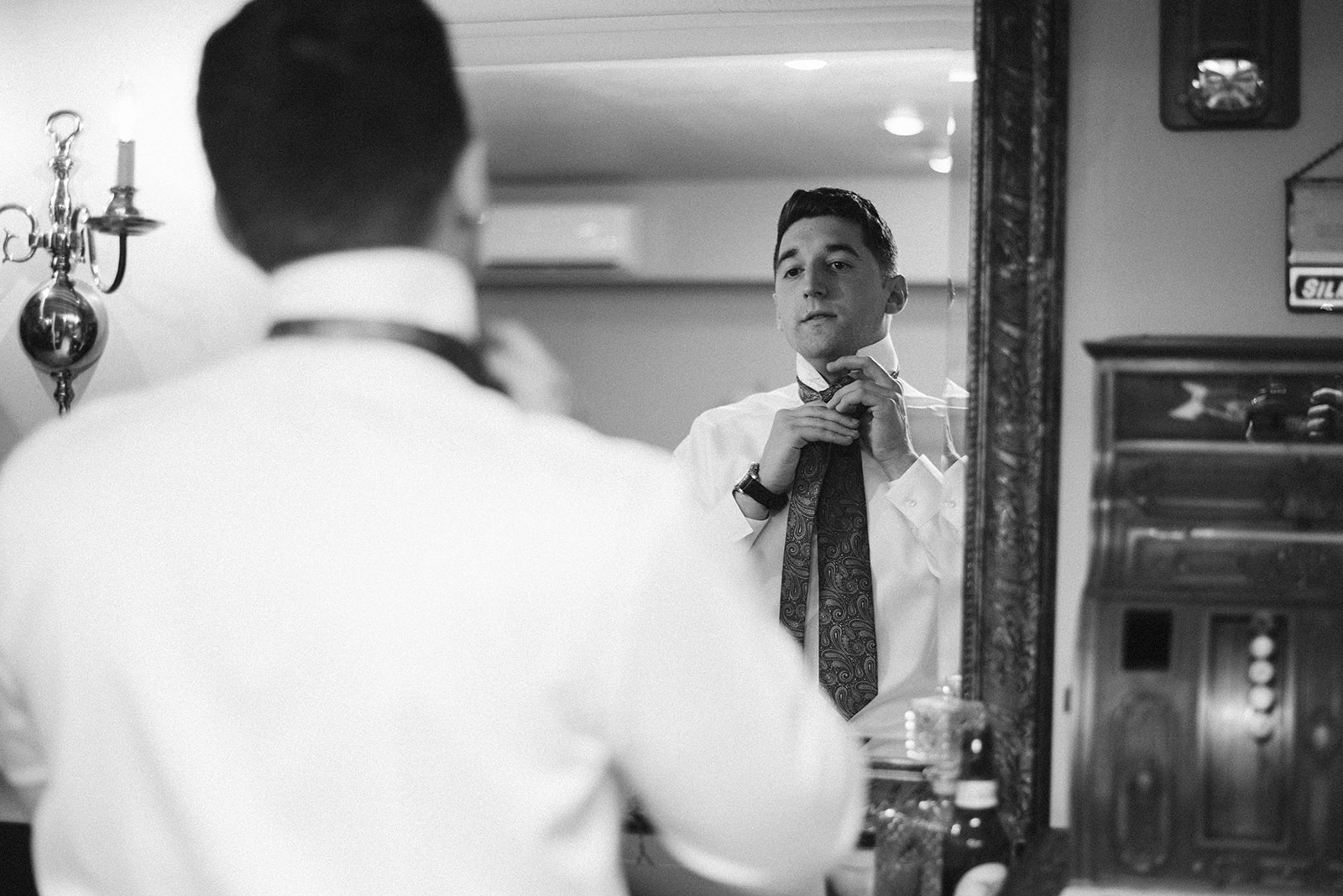 The groom is getting ready in the groom's suite at Drumore Estate prior to his wedding ceremony.
