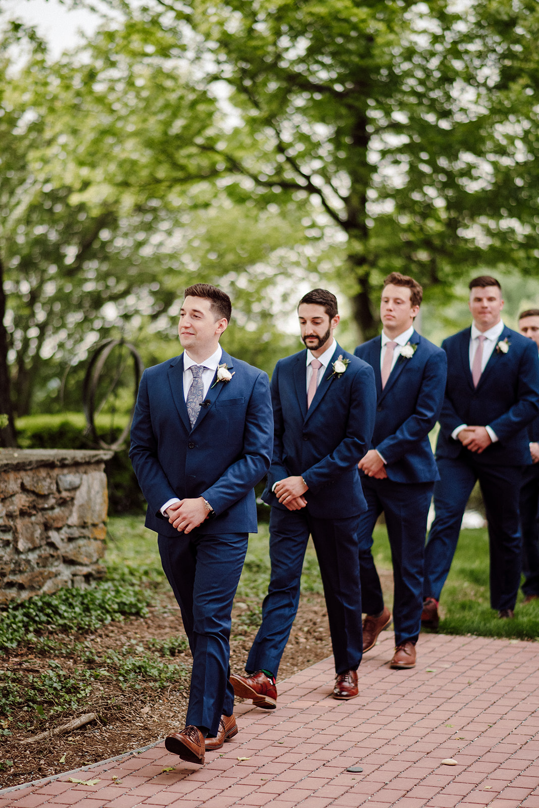 The groom and his groomsmen enter the wedding ceremony at Drumore Estate.