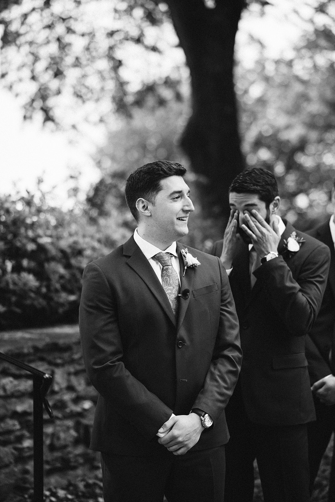The groom gets emotional as he sees his bride walk down the aisle during their ceremony.