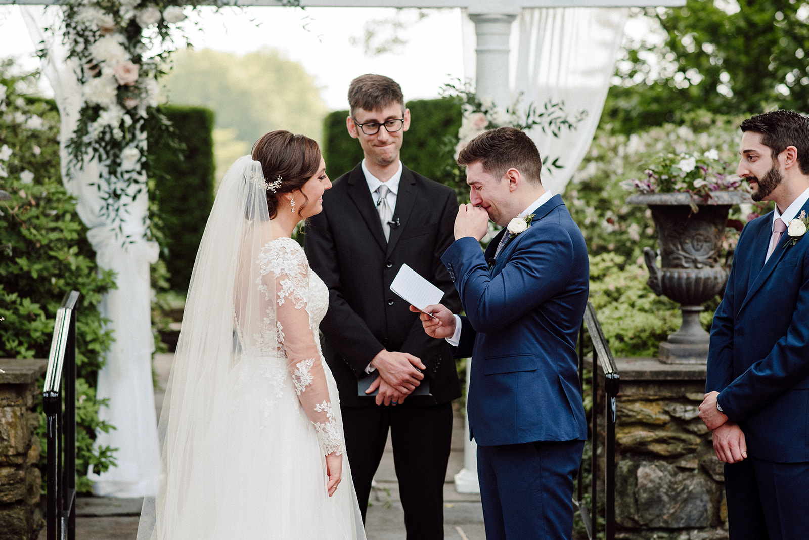 Andrew reads his vows through tears during his outdoor wedding ceremony at Drumore Estate.