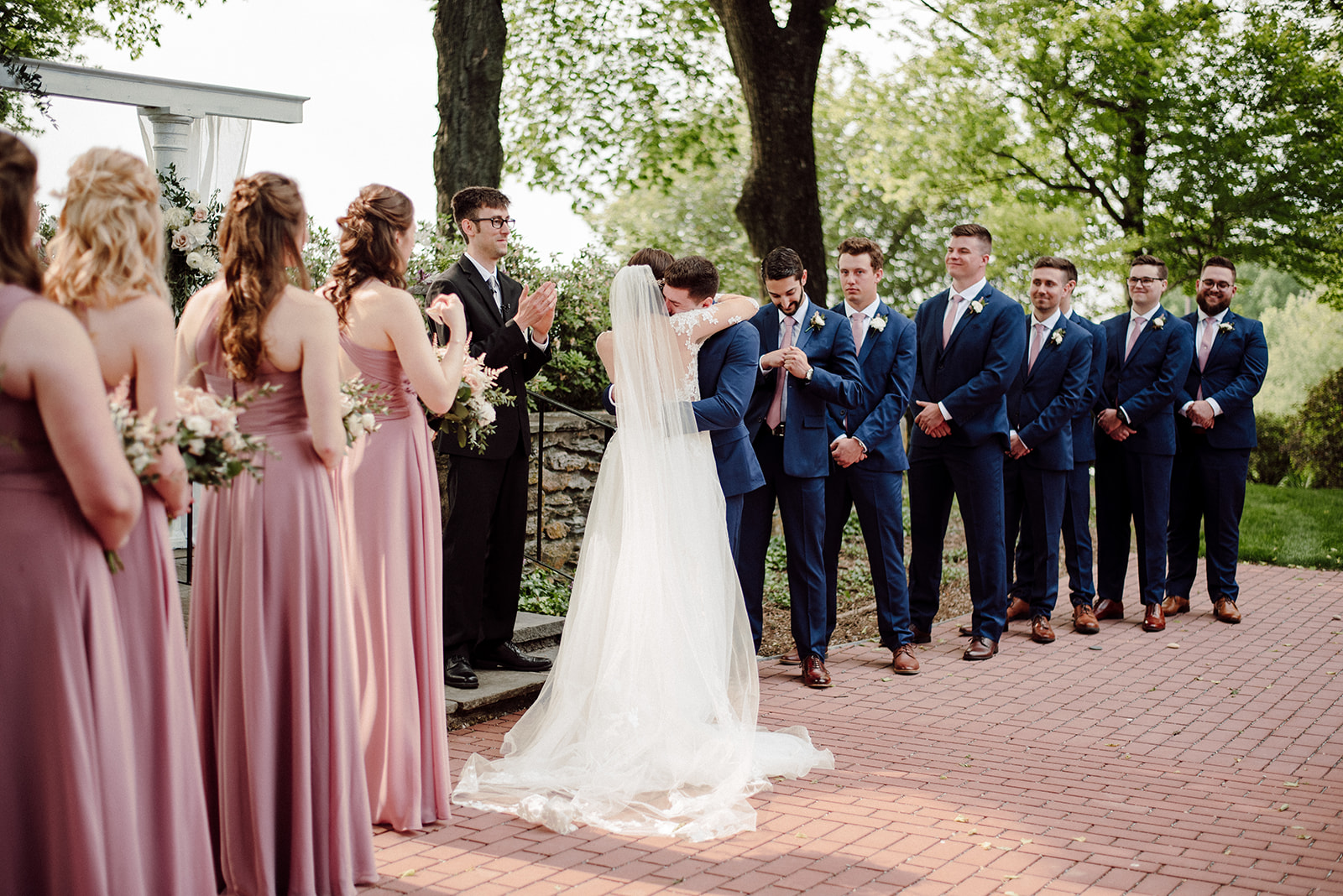 Bride and groom share an emotional embrace after reading their vows to one another.