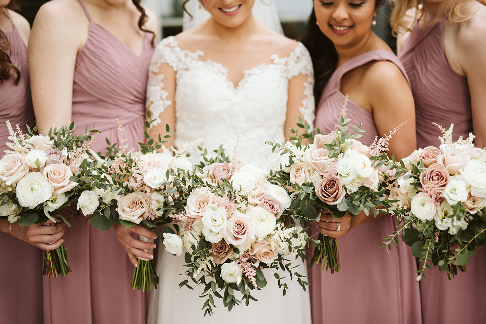 Mauve and peach bridal and bridesmaids bouquets.
