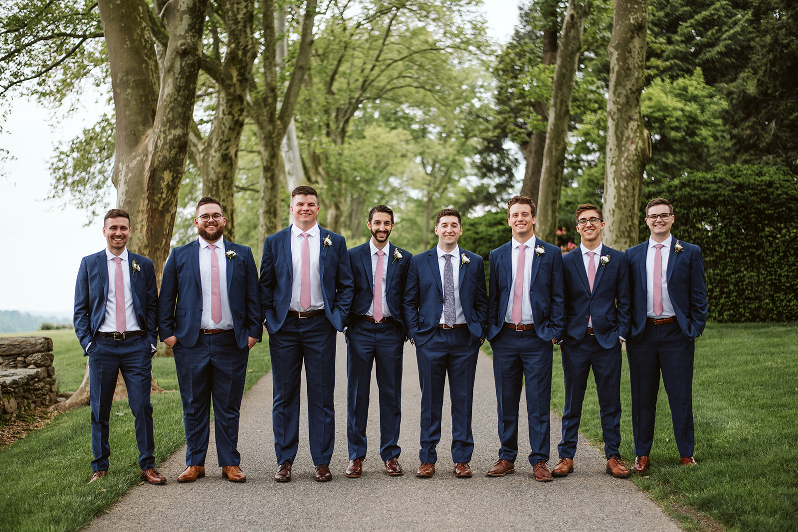 A groom and his groomsmen pose at their Drumore Estate wedding.