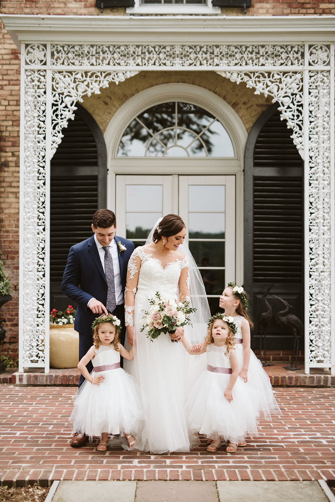 Bride and groom with their flower girls on their wedding day.
