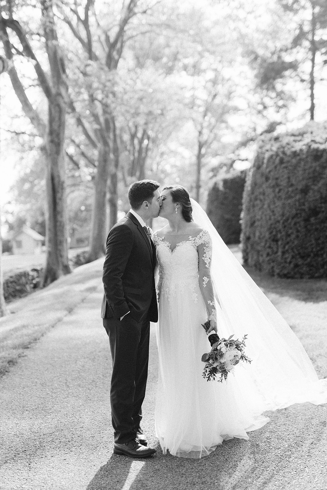 Bride and groom kiss at Drumore Estate.