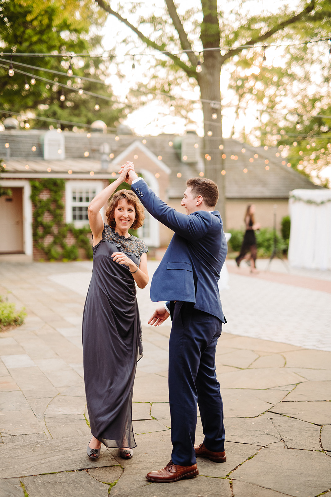 Groom gives his mother a twirl during their dance at their Drumore Estate wedding reception.