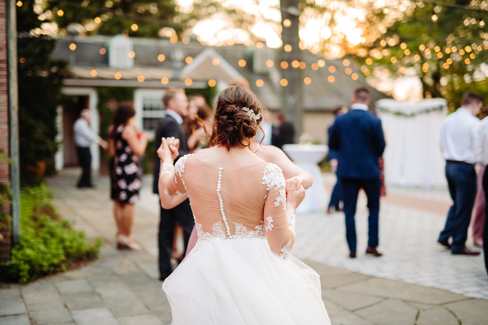 A bride dancing during the wedding reception.
