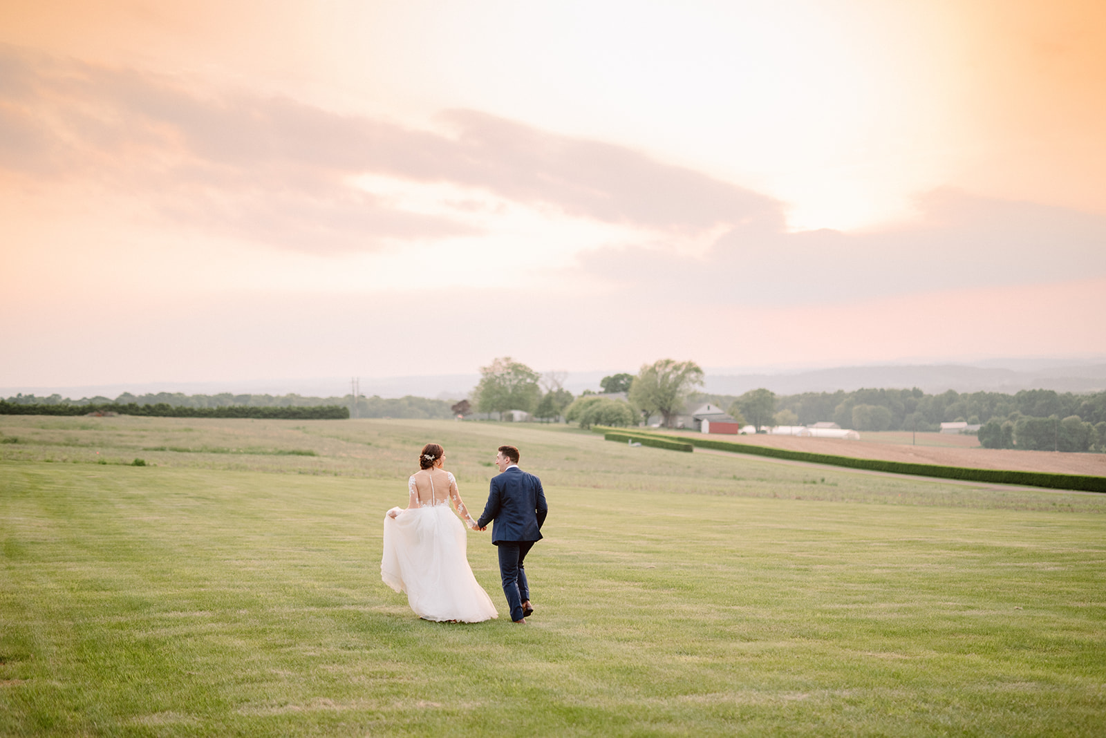 Bride and Groom enjoy a sunset at Drumore Estate during their wedding day.