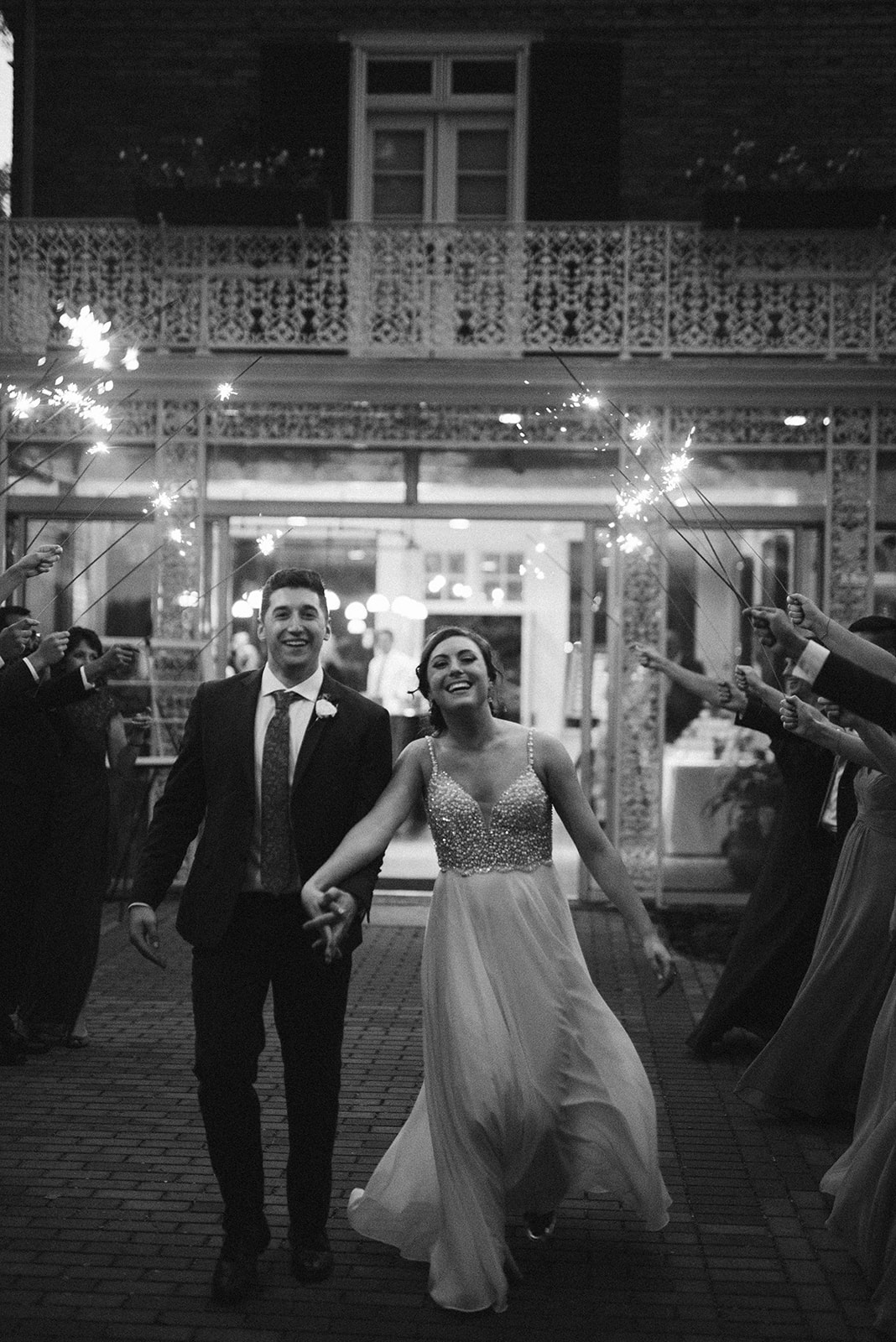Bride and groom run through sparklers at the end of their reception during their wedding at Drumore Estate.