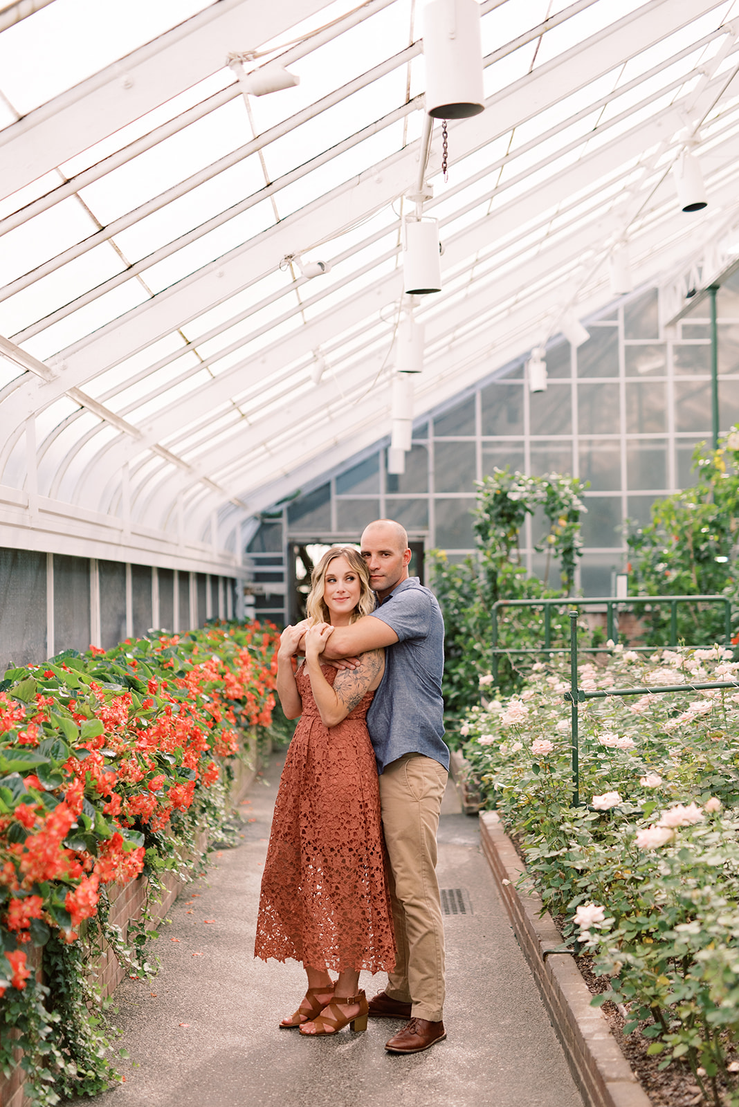 Engagement photos in a greenhouse at Longwood Gardens.