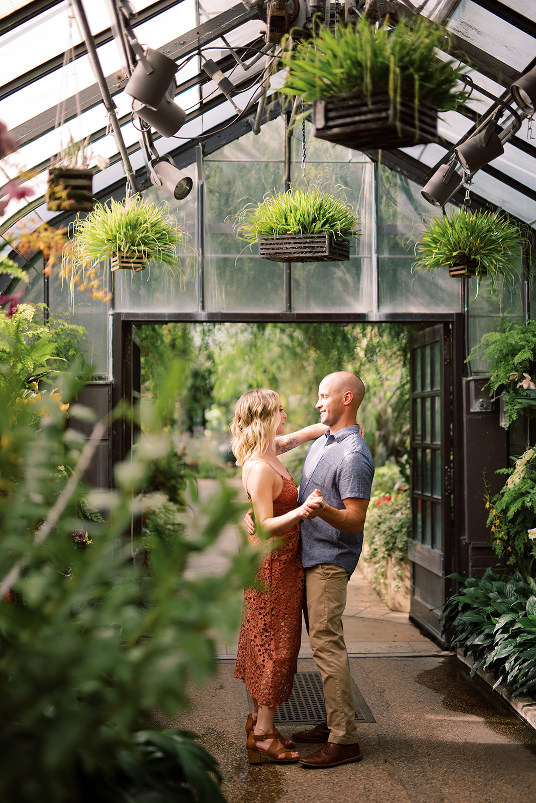 Taking engagement photos in the orchid room of the Longwood Gardens conservatory.