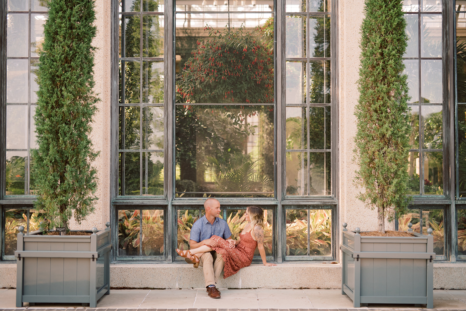 Taking engagement photos outside of the conservatory at Longwood Gardens.