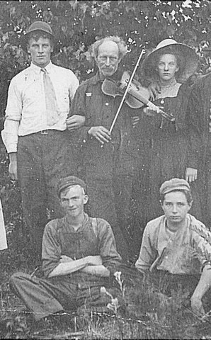 Grover (back, left) and Tuden (back, center) were well known in the township and lumber camps for their musical skills.