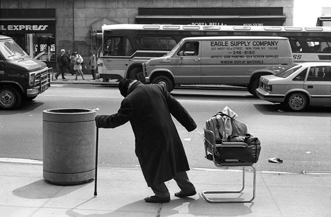 Man-pulling-chair.jpg