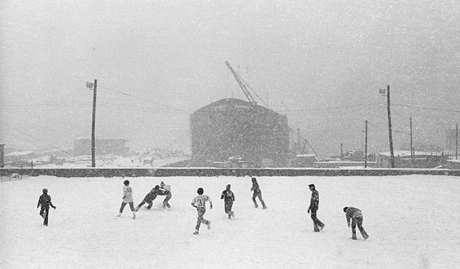 Boys-playing-football-snow.jpg