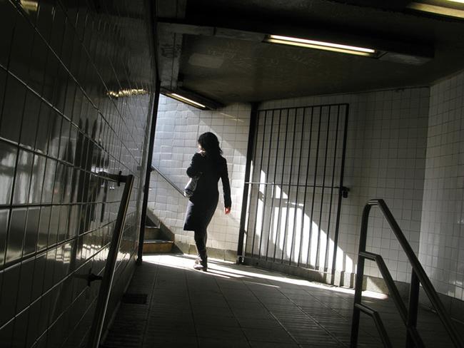 Woman-exiting-subway-station.jpg