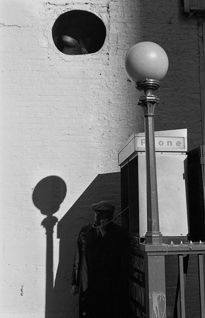 Man-at-subway-telephone.jpg