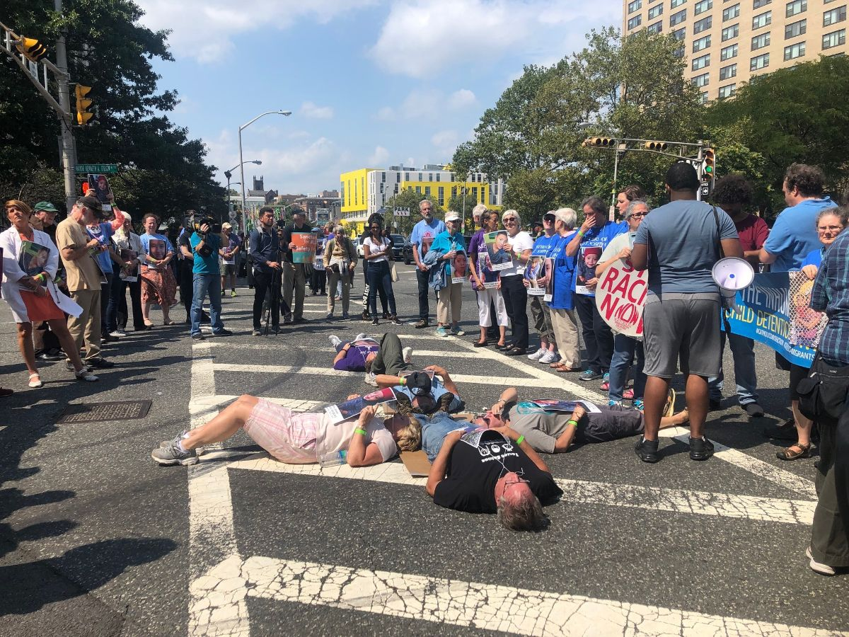 Demonstrators in Newark, lie in the shape of a cross during an act of civil disobedience.