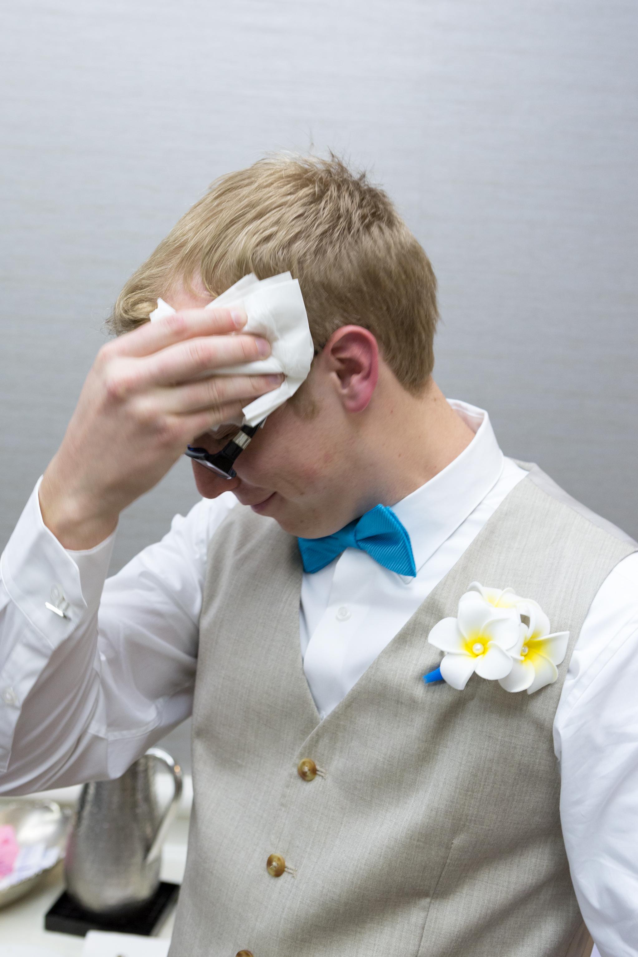 groom_getting_ready_ring_wedding_5.jpg