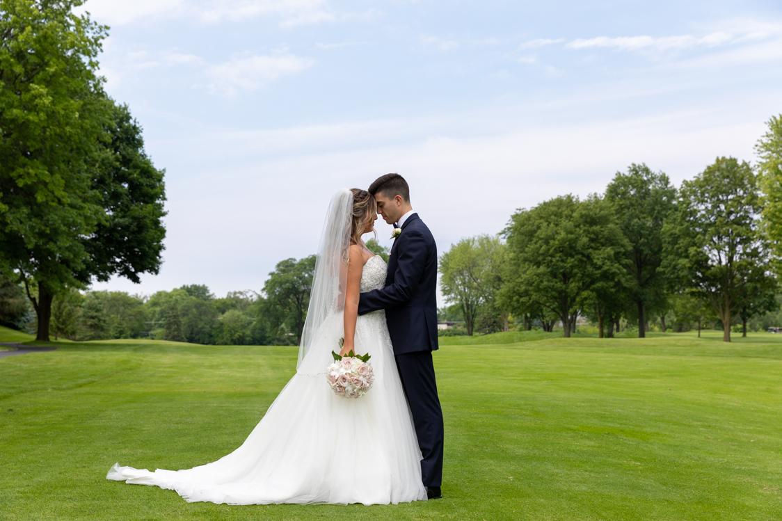 jess_alex_wedding_cary_illinois_ring_flowers_golf_course.jpg