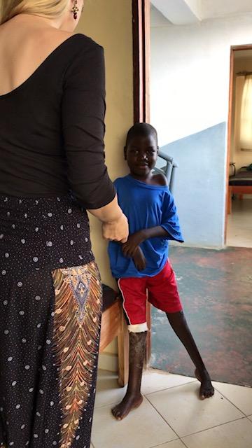 Jekonia standing at the OVI Children's Hospital