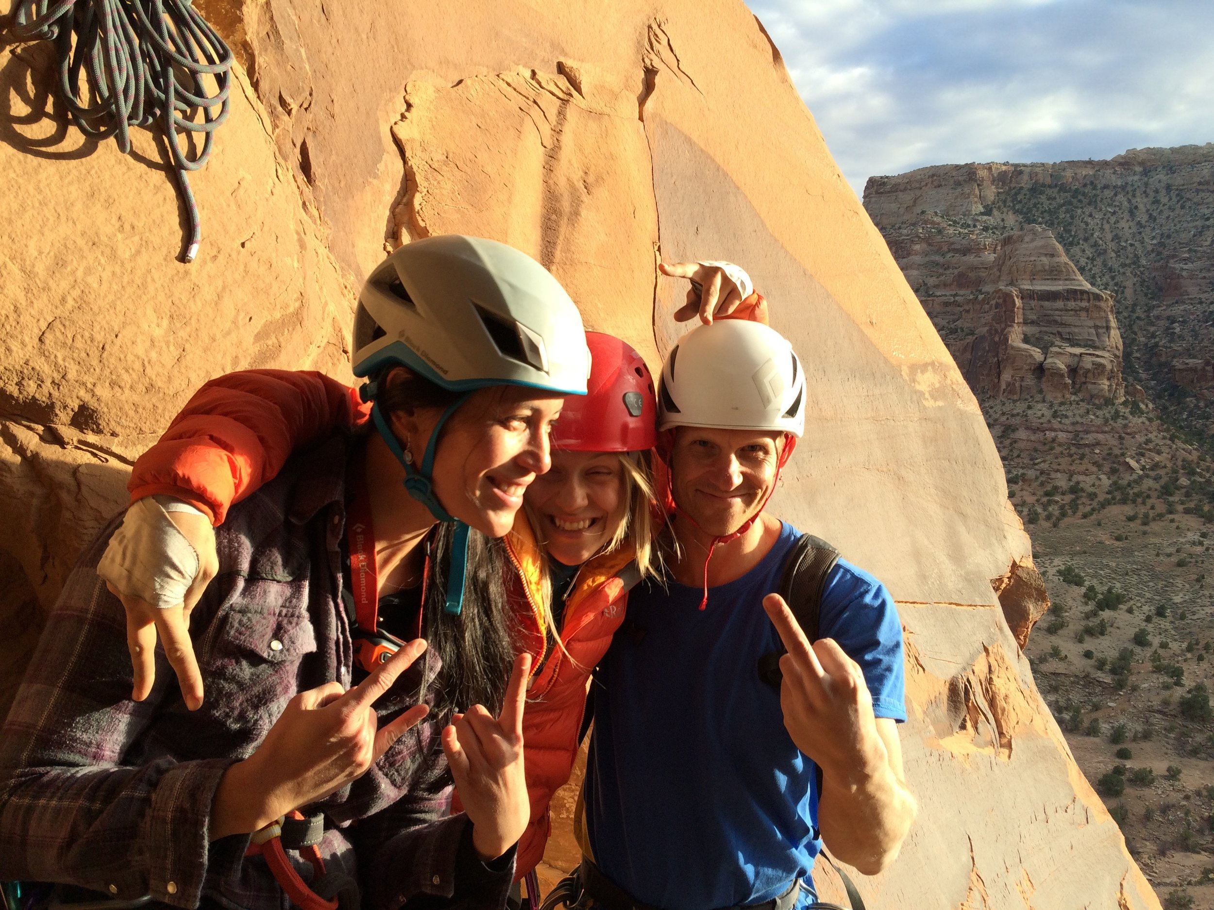 Juanita and Josh throwing gang  signs on haagenshlong tower, San Rafel Swell, Utah, USA