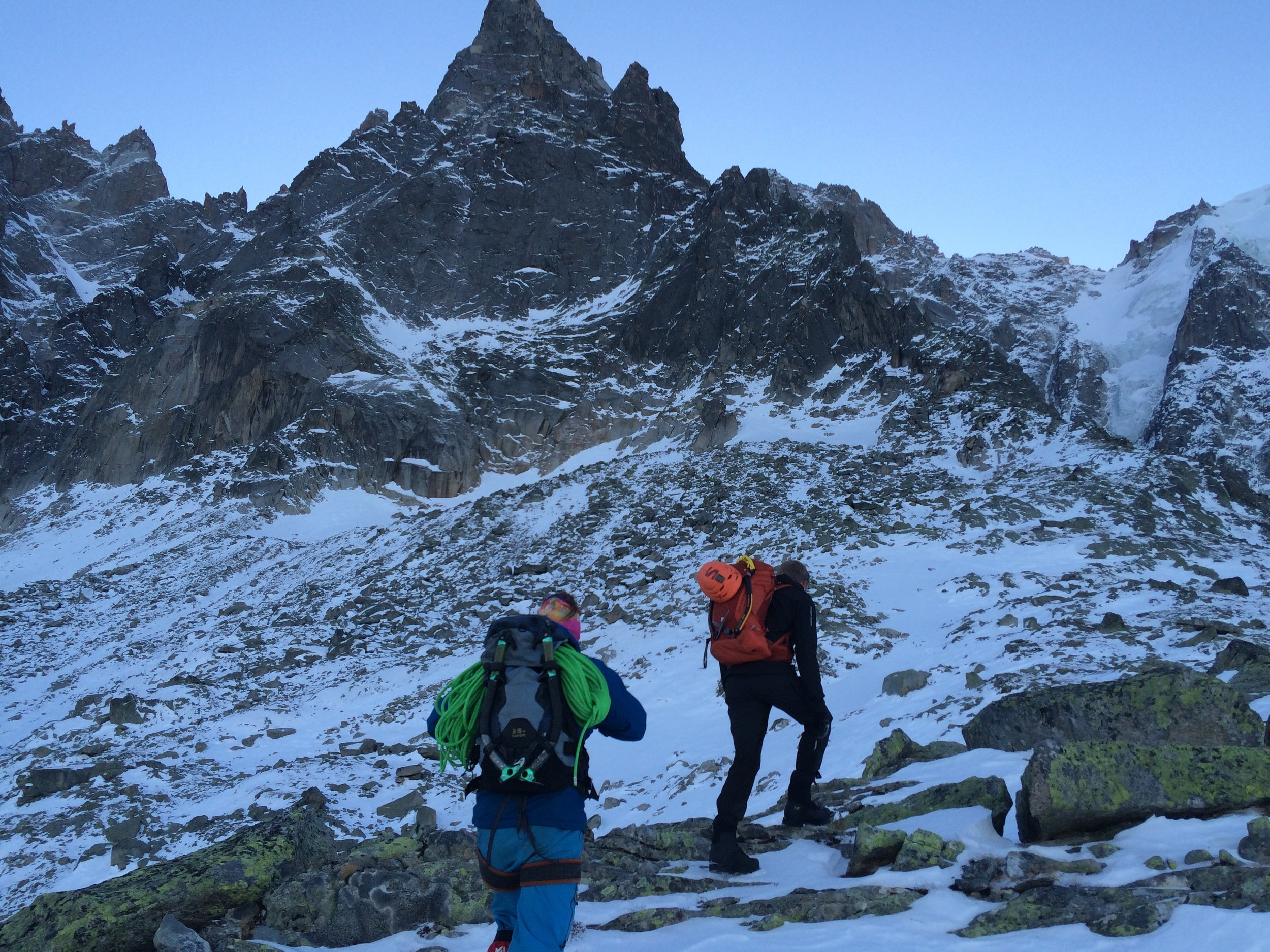 Pete and Dave Searle approaching our route,  Cecile et la mesange on the Aiguille du Peigne