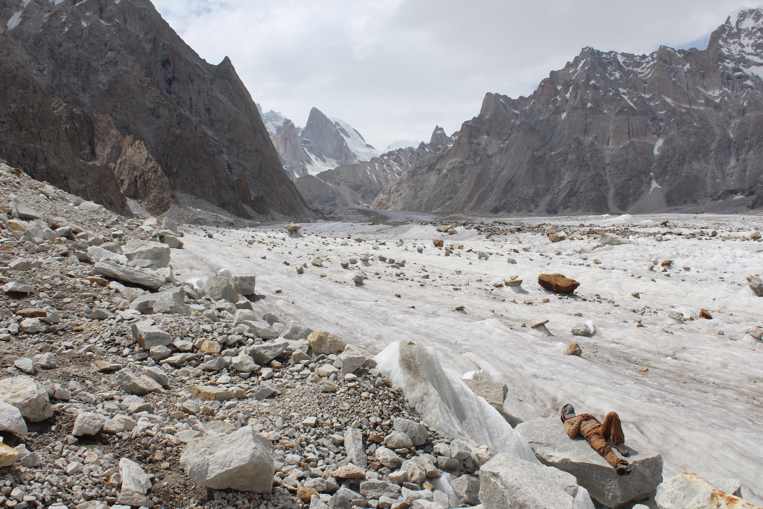 Ghafoor taking a mid day nap next to our glacial highway to basecamp.