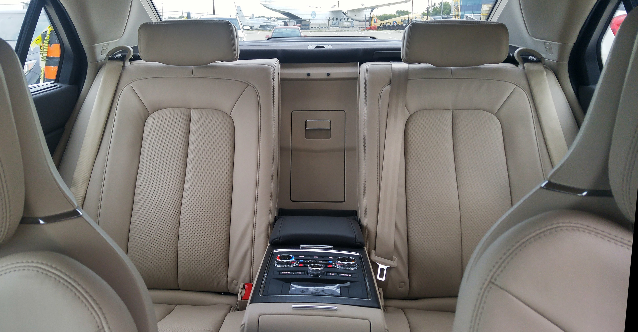 The Rear Seat Package includes a full-function audio and climate control panel with an LCD display.