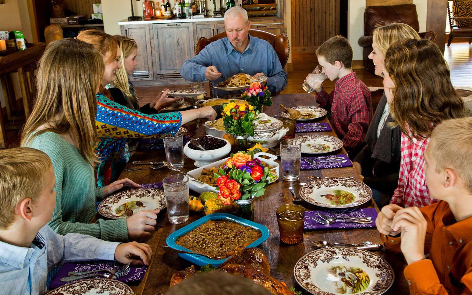 """Drummond family at thanksgiving dinner, with """"Marlboro Man"""" at the head of the table. Photo by Peter Frank Edwards for  Parade"""