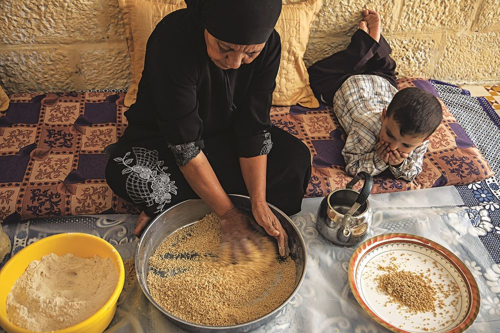 "This photo, taken as part of  Saveur 's feature called ""The Heart of Palestine"", shows the process of making maftoul from scratch. The recipe I followed to make maftoul was part of this feature. Photo by   Saveur  ."