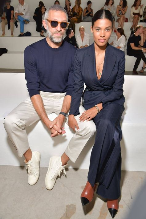 Spring 2019 - Black have you feeling a little goth sometimes? Try navy blue as a chic alternative. Power couple Vincent Cassel and Tina Kunakey wear this spring trend effortlessly in matching navy blue at Roberto Cavalli Spring/Summer 2019 Fashion Show.