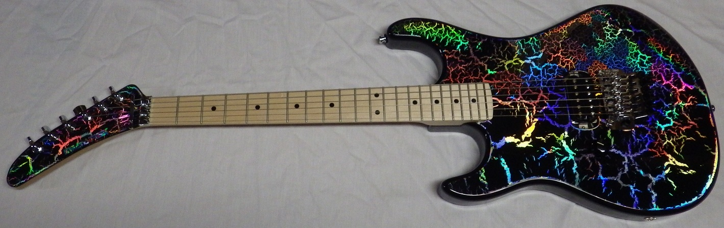 Mean Street Custom Unchained HoloCrackle 719  Tour Model (left-handed). Poplar body, 1pc Maple neck, 22 6150 frets, EVH Frankenstein pickup, Original Floyd Rose, Gotoh tuners an a Holocrackle finish that will blow your mind!! Checkout the videos on youtube…$1795 (Sold)