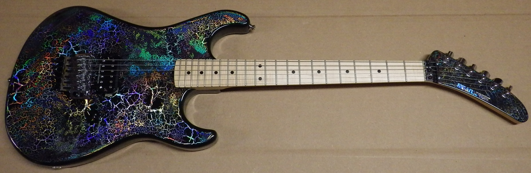 Mean Street Unchained Tour Model (Holocrackle420)  with wicked Holocrackle paint job and matching headstock, Poplar body, light flame 1 piece rock maple neck, R2 nut, 22 medium jumbo frets, Original Floyd Rose tremolo, Seymour Duncan TB14 Custom 5 pickup, Gotoh tuners, strap locks, CTS pot, Switchcraft jack...comes with Gator case. $1795 plus shipping (SOLD)