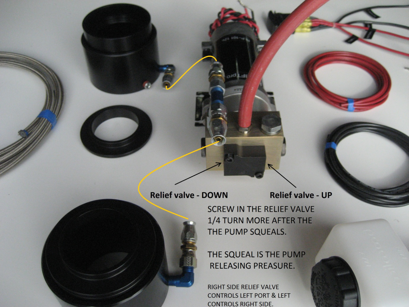Layout of the lift kit; this one shows a front setup. Plumbing in another 2 pucks is needed to lift the entire car.