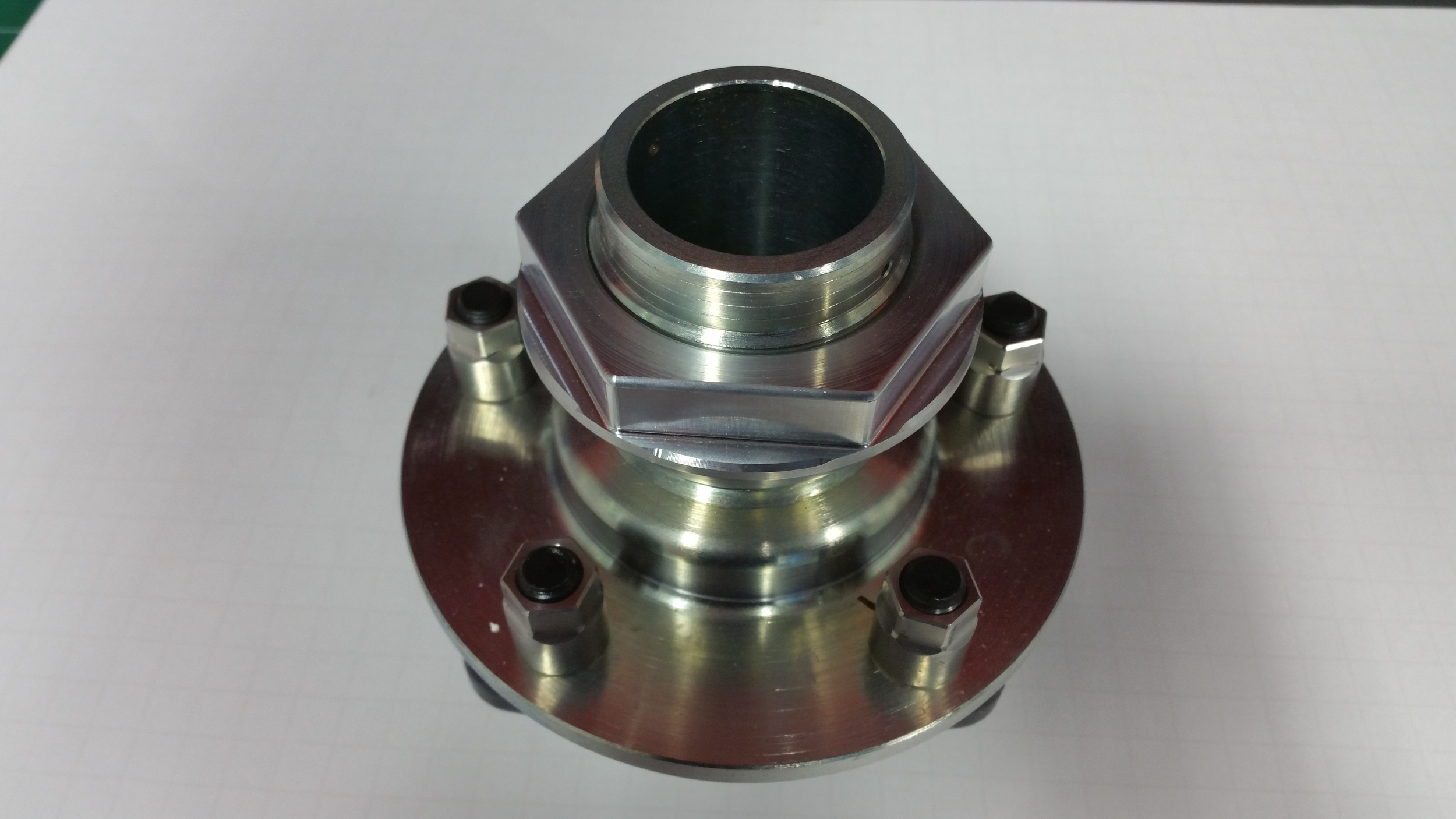 Centerlock wheel adapter from Superlite Cars mounted on a hub to show pins and nut detail